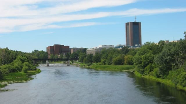 {{GFDL}} Carleton University in Ottawa, Ontario, Canada; August 2004; seen from the Bronson St. Bridge over the Rideau River