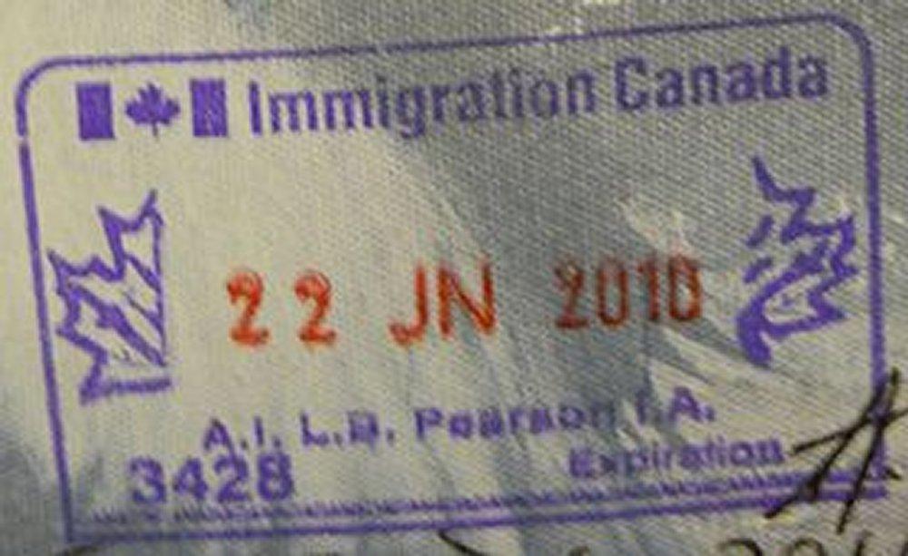 Immigration Stamp By Vampireshark (Own work) [CC0], via Wikimedia Commons