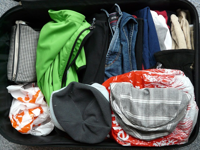 Clothes in a suitcase via https://pixabay.com/en/luggage-travel-holiday-packaging-64354/