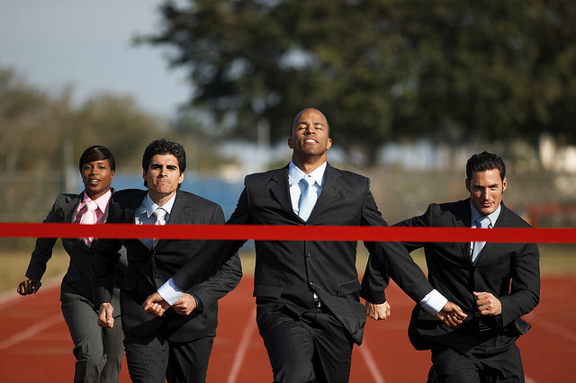 Business Executives Running a Race by Corbis