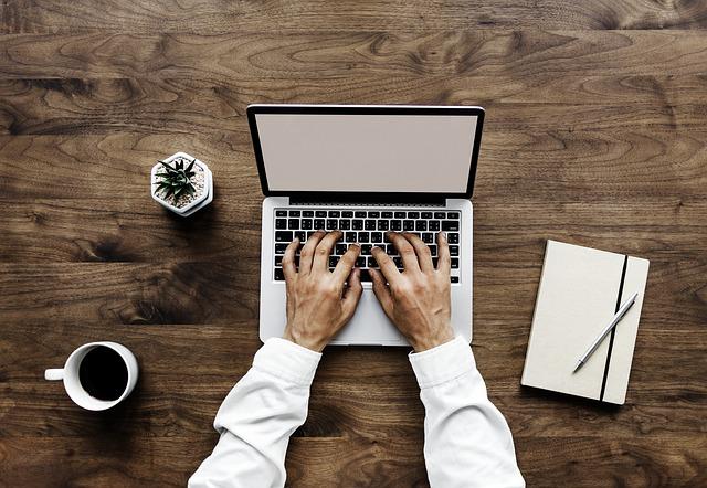 Laptop via https://pixabay.com/en/laptop-table-paper-wood-desktop-3242862/