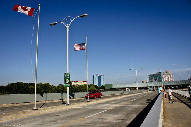 Walking across the border via https://www.flickr.com/photos/dark-wretch/4723161411/