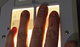 Fingerprint Scanner By U.S. Air Force photo/Staff Sgt. Marc I. Lane [Public domain], via Wikimedia Commons