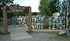 """Watson Lake Signpost"" by Original uploader was Jadecolour at en.wikipedia - Transferred from en.wikipedia; transferred to Commons by User:Zanka using CommonsHelper.. Licensed under Creative Commons Attribution-Share Alike 3.0 via Wikimedia Commons - http://commons.wikimedia.org/wiki/File:Watson_Lake_Signpost.jpg#mediaviewer/File:Watson_Lake_Signpost.jpg"