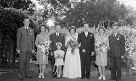 Wedding by Conrad Poirier [Public domain or Public domain], via Wikimedia Commons