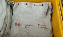 Canada Post bag By User:WayneRay Wayne Ray [Public domain], via Wikimedia Commons