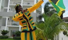 Jamaican man via https://pixabay.com/en/jamaica-celebration-flag-national-679366/