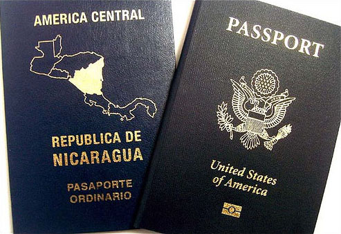 Two passports representing dual citizenship by https://www.flickr.com/photos/lanicoya_/ https://creativecommons.org/licenses/by/2.0/deed.en