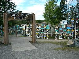 """Watson Lake Signpost"" by Original uploader was Jadecolour at en.wikipedia - Transferred from en.wikipedia; transferred to Commons by User:Zanka using CommonsHelper.. Licensed under Creative Commons Attribution-Share Alike 3.0 via Wikimedia Commons - https://commons.wikimedia.org/wiki/File:Watson_Lake_Signpost.jpg#mediaviewer/File:Watson_Lake_Signpost.jpg"
