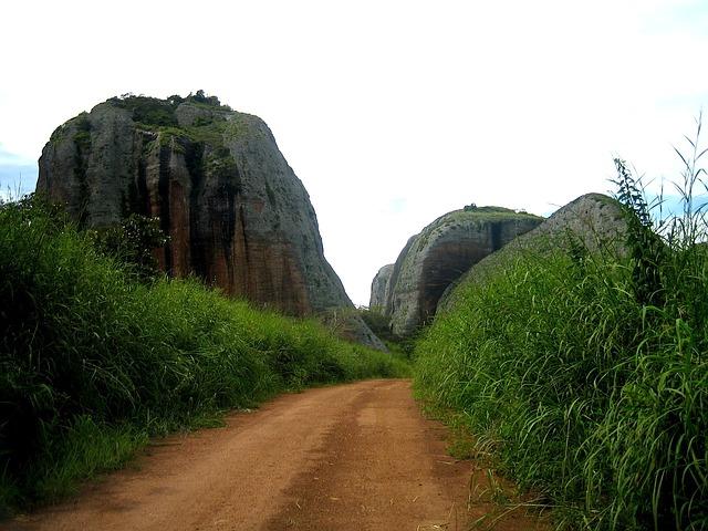 Angola road via https://pixabay.com/en/angola-sky-clouds-rocks-stones-78212/