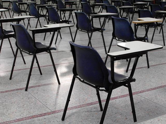 Empty Desks via https://pixabay.com/en/empty-exam-hall-deserted-nobody-314554/
