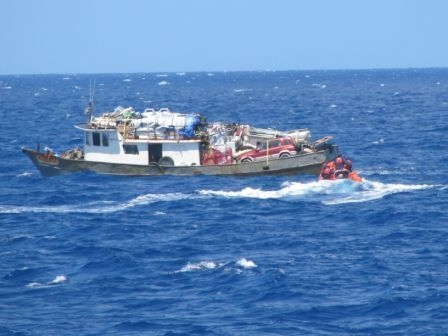 USCG Rescuing Haitian Refugees via https://commons.wikimedia.org/wiki/File:USCG_sailors_rescuing_Haitian_refugees_-b.jpg?uselang=en-gb