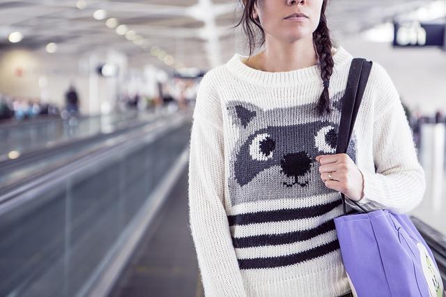 Woman at Airport via https://pixabay.com/en/woman-airport-girl-travel-female-594465/