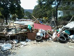 A barricade built by protesters blocking a street [Public Domain]