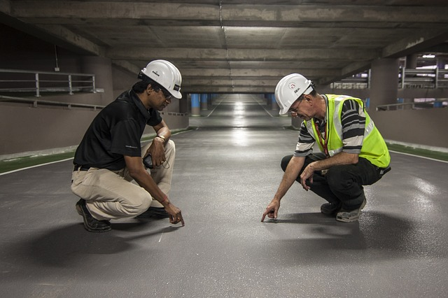 Two men inspecting work