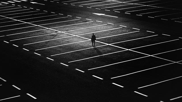 Lonely in an empty parking lot via https://pixabay.com/en/city-people-street-night-lights-1487891/