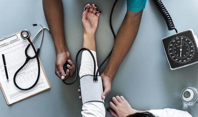 Nurse via https://pixabay.com/en/woman-person-desktop-work-aerial-3187087/