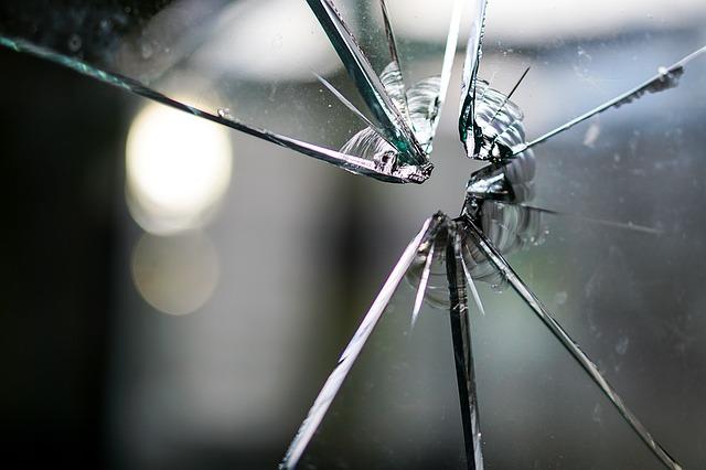 Broken Glass via https://pixabay.com/en/glass-broken-fragmented-hole-crack-1497227/