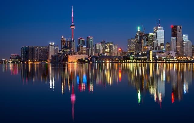 Toronto via https://pixabay.com/photos/buildings-cn-tower-canada-colorful-2297210/