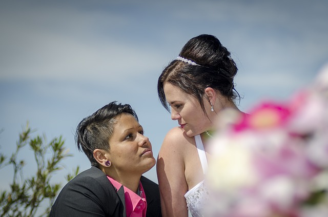 Lesbian couple via https://pixabay.com/photos/bride-and-groom-before-love-marry-1825873/