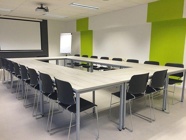 Classroom via https://pixabay.com/photos/meeting-modern-room-conference-1177454/